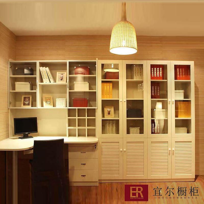 Книжные шкафы угловые с встроенным столом.
