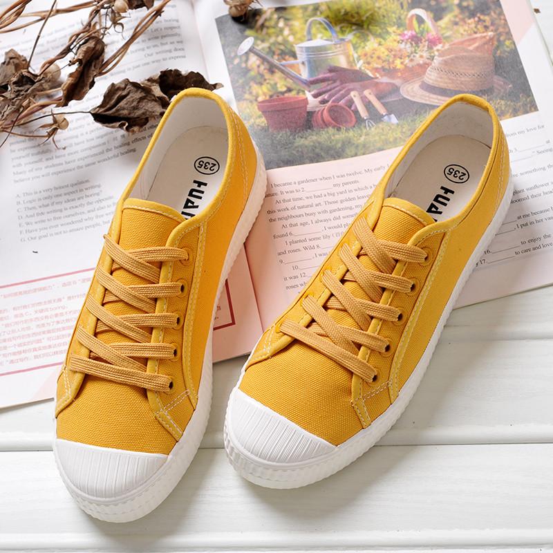 黄色帆布鞋 环球韩版女士休闲平跟帆布鞋春季透气低帮贝壳女鞋中学生黄色板鞋_推荐淘宝好看的黄色帆布鞋