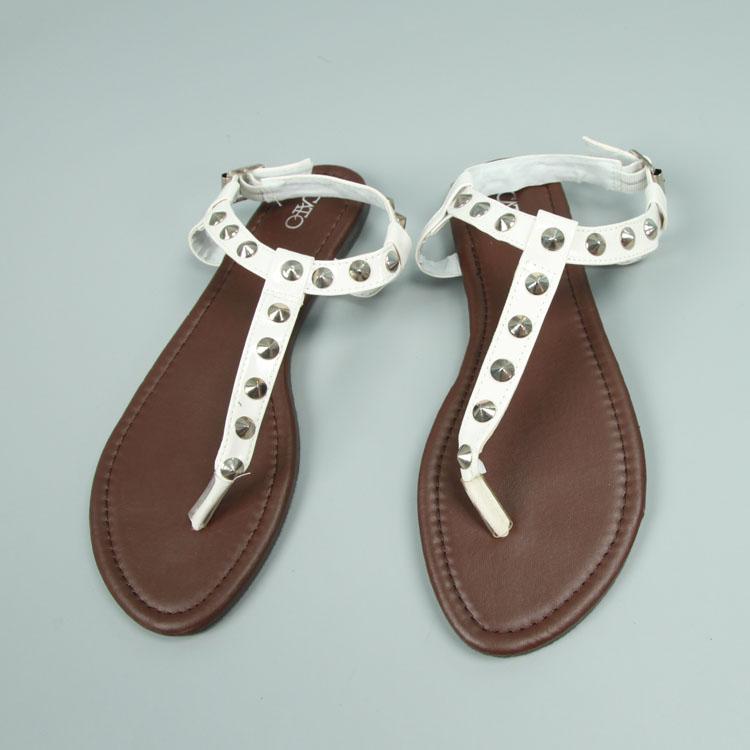 罗马平底鞋 包邮铆钉夹脚平底罗马凉鞋女大码鞋_推荐淘宝好看的女罗马平底鞋