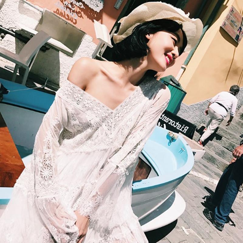 白色蕾丝连衣裙 度假裙2017秋装新款白色V领性感镂空蕾丝裙超仙海边沙滩连衣裙女_推荐淘宝好看的白色蕾丝连衣裙