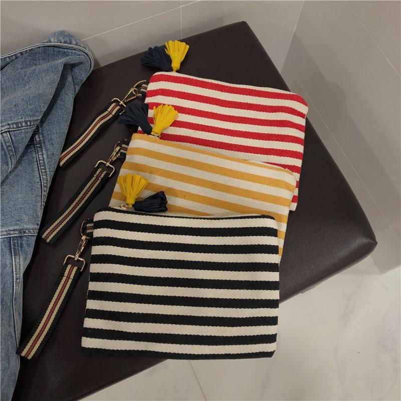 红色信封包 信封包女2020新款时尚chic条纹红绿黑白条纹包手拿包帆布大容量_推荐淘宝好看的红色信封包