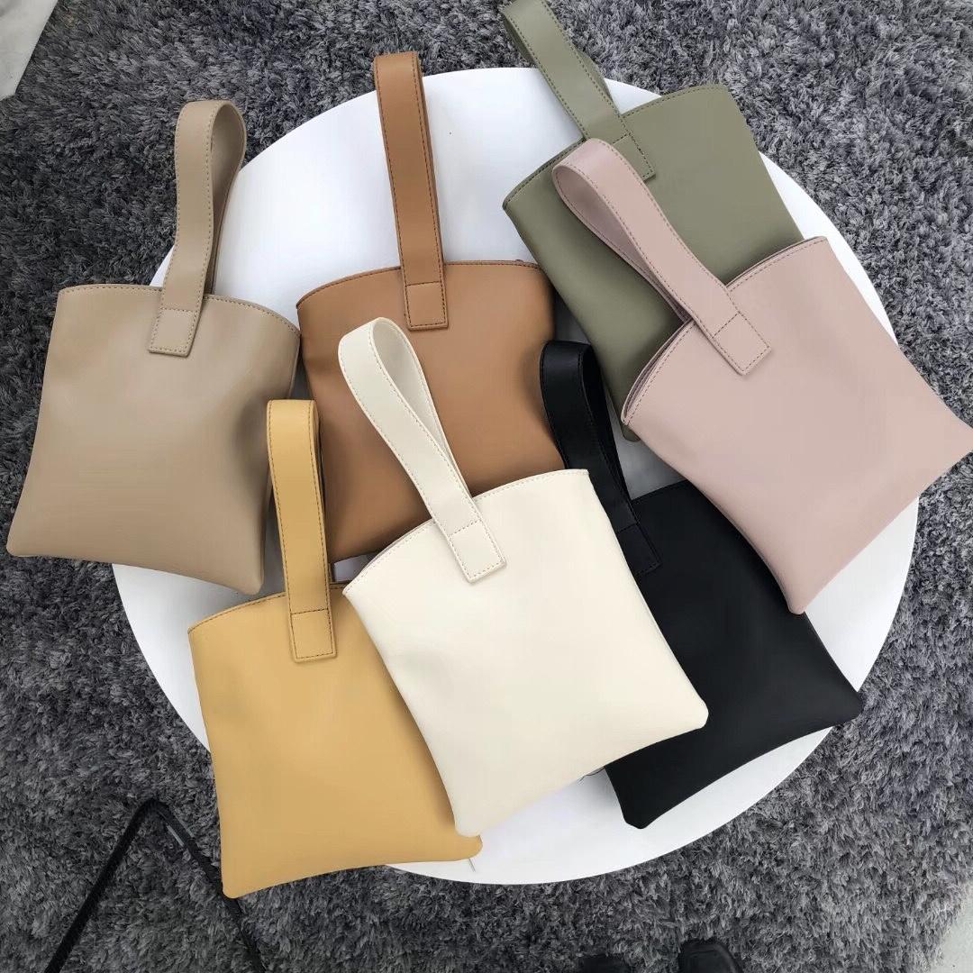 黄色手拿包 INS极简个性设计同款韩版软面小巧纯色手提包手拿pu包包女手机包_推荐淘宝好看的黄色手拿包