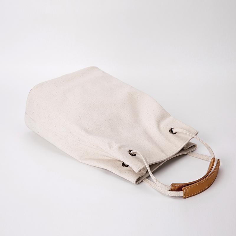 白色单肩包 YONBEN元本良厂白色帆布包女 单肩文艺小清新水桶单肩包简约布包_推荐淘宝好看的白色单肩包