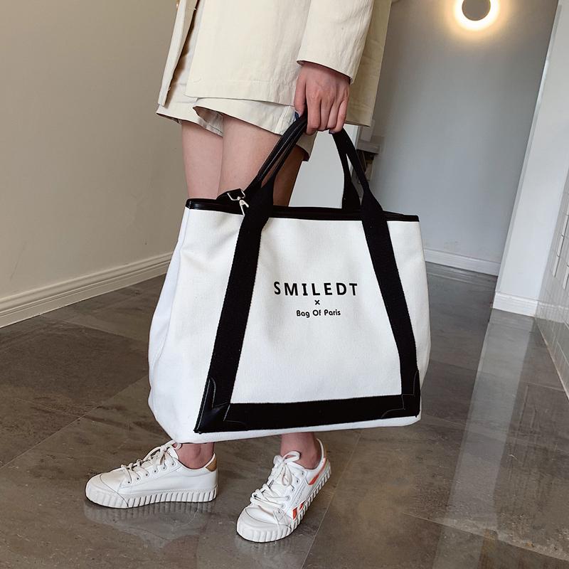 欧美时尚手提包 大包包2021新款女包欧美时尚帆布包潮字母单肩包大容量手提斜挎包_推荐淘宝好看的女欧美手提包