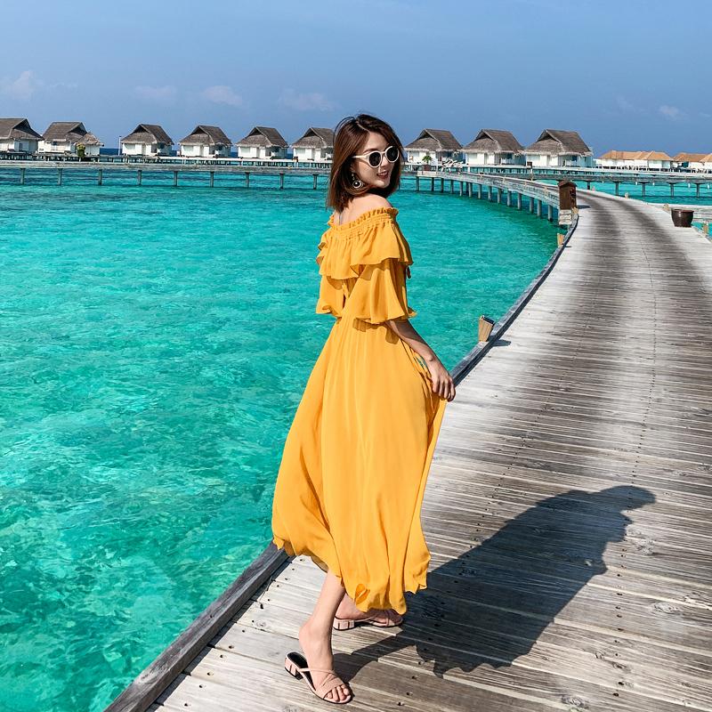 黄色连衣裙 岛歌夫人2020新款女夏沙滩裙海边度假裙一字领显瘦长裙黄色连衣裙_推荐淘宝好看的黄色连衣裙