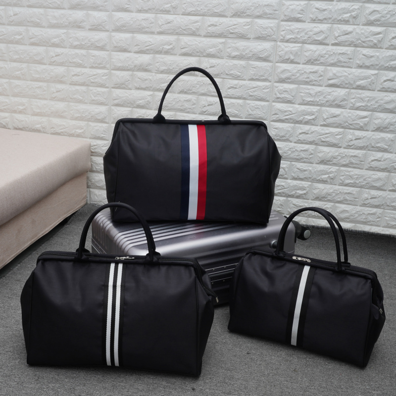 韩版时尚手提包 韩版大容量旅行袋手提旅行袋可装衣服的包包行李包女简约旅游包男_推荐淘宝好看的女韩版手提包