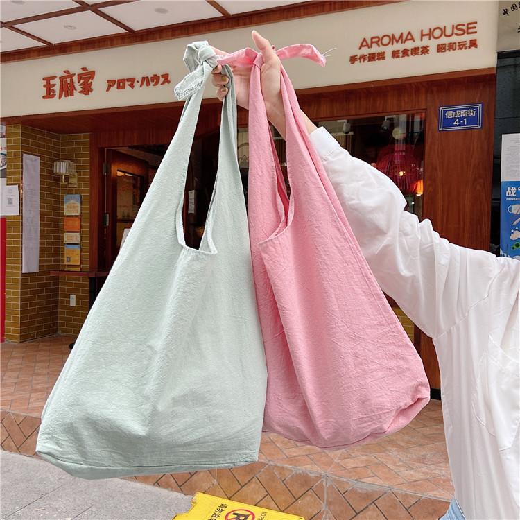 绿色手提包 纯色打结豆绿色百搭单肩包大容量女文艺复古背心式手提购物袋韩版_推荐淘宝好看的绿色手提包