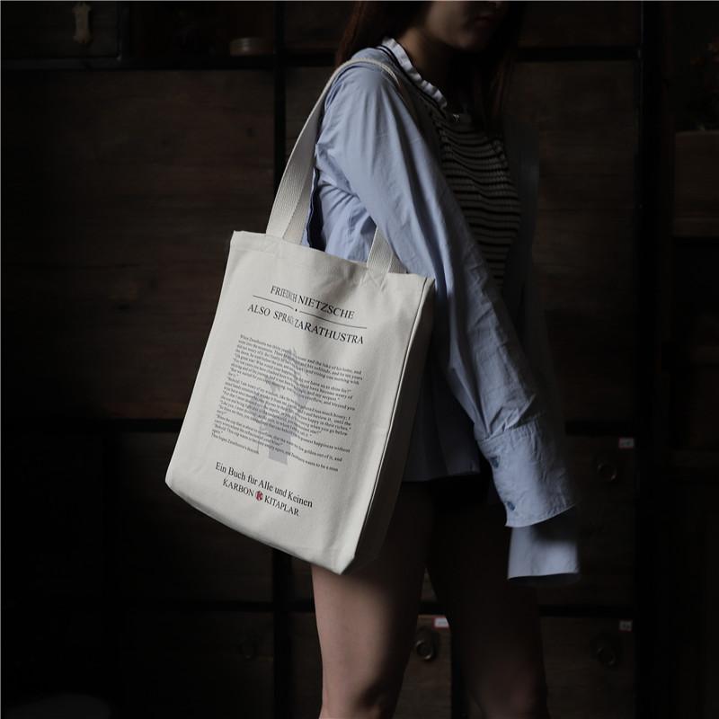 学生单肩包 原创尼采《查拉斯图拉如是说》男女单肩帆布包定制斜挎文艺学生包_推荐淘宝好看的女学生单肩包