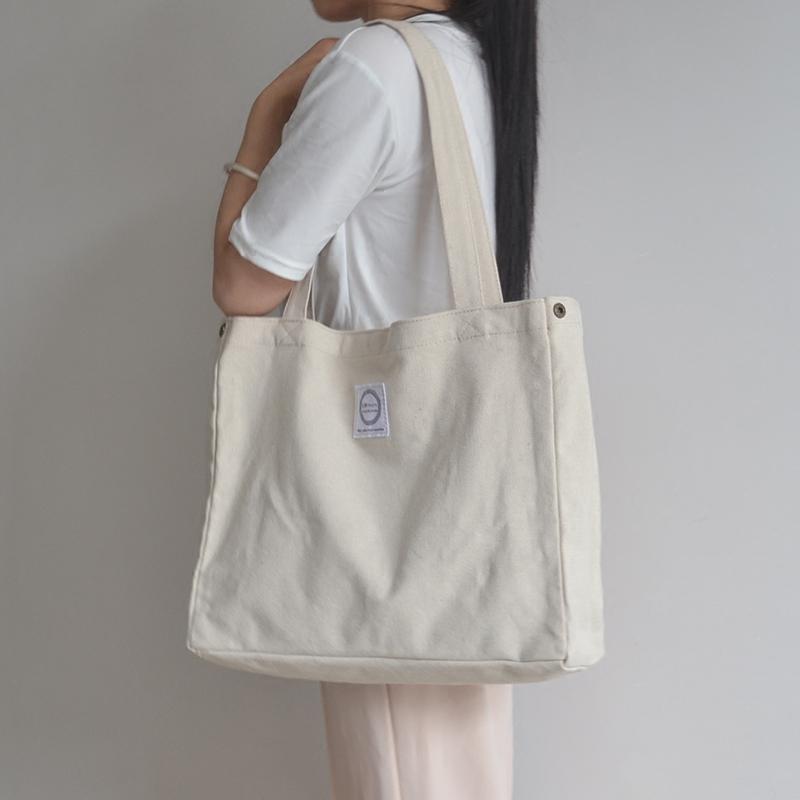 白色手提包 大容量帆布包女手提包韩版休闲单肩包学生白色文艺帆布袋简约百搭_推荐淘宝好看的白色手提包