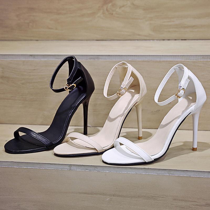 白色鱼嘴鞋 白色高跟鞋女夏新款性感细跟百搭露趾中空一字扣10cm超高凉鞋女潮_推荐淘宝好看的白色鱼嘴鞋