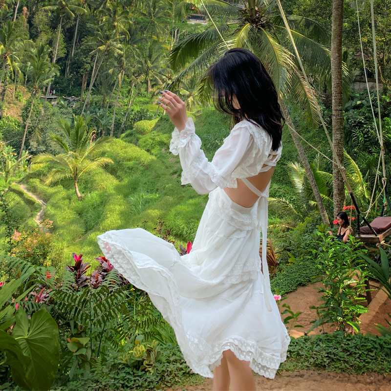 白色连衣裙 秋冬新款海边度假沙滩裙白色仙女花边大摆露背性感长裙超仙连衣裙_推荐淘宝好看的白色连衣裙