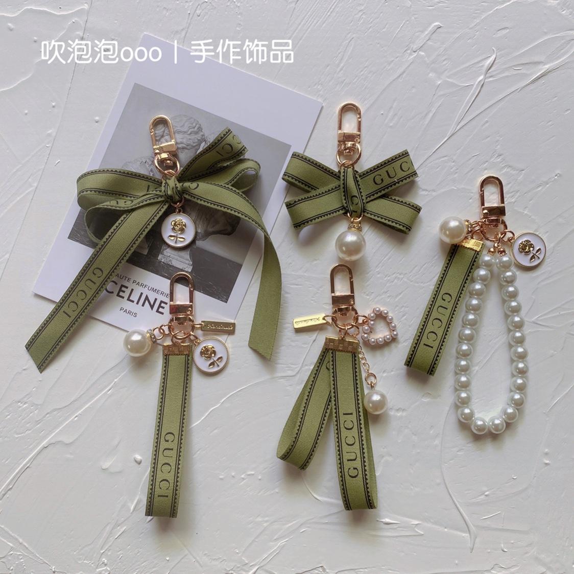 绿色贝壳包 原创手工挂绳小巧精致保色挂件绿色珍珠链贝壳钥匙扣仙女包包挂饰_推荐淘宝好看的绿色贝壳包