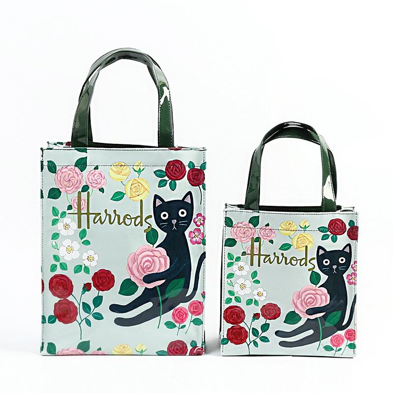 粉红色手提包 欧洲风情英伦名品环保PVC印花大容量防水购物袋手提包女包包袋_推荐淘宝好看的粉红色手提包