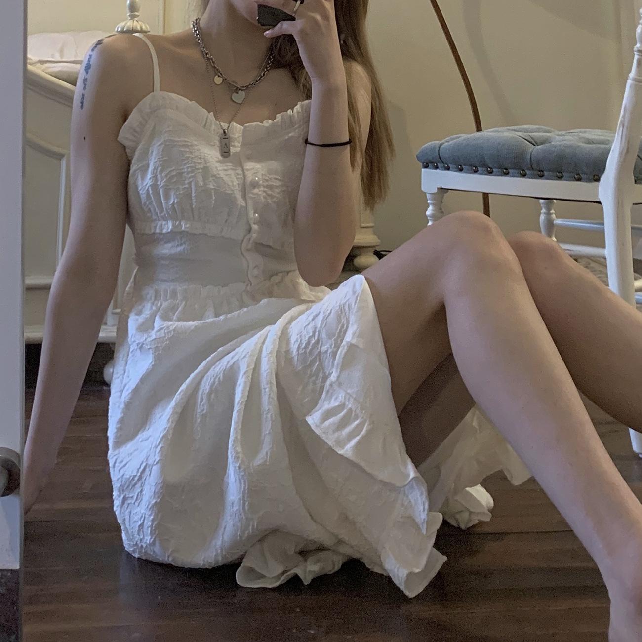 白色吊带连衣裙 白色吊带裙女2021年春夏新款法式开叉连衣裙子少女修身显瘦长裙_推荐淘宝好看的白色吊带连衣裙