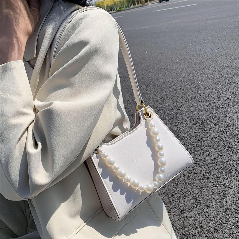 紫色手提包 法国小众小包包女2020流行新款潮韩版百搭洋气珍珠手提单肩腋下包_推荐淘宝好看的紫色手提包