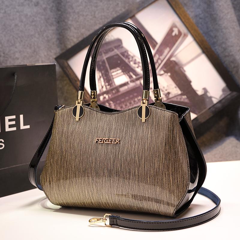 欧美时尚手提包 欧美时尚包包2020新款手提包漆皮中年女包妈妈包真皮单肩斜挎大包_推荐淘宝好看的女欧美手提包