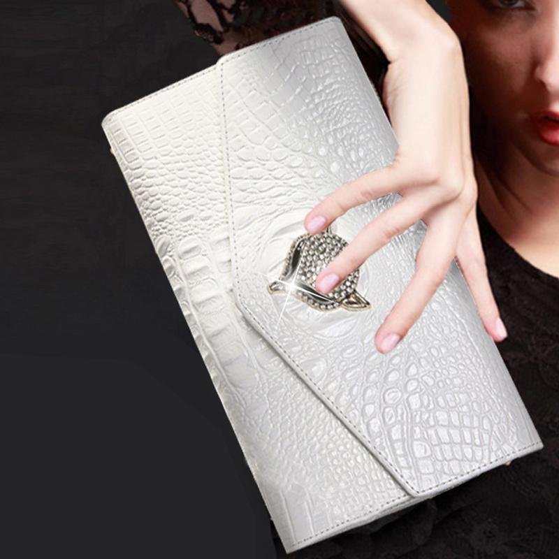 白色斜挎包 2021新款女士真皮手拿包女包时尚手抓包白色手包斜挎包气质小包包_推荐淘宝好看的白色斜挎包