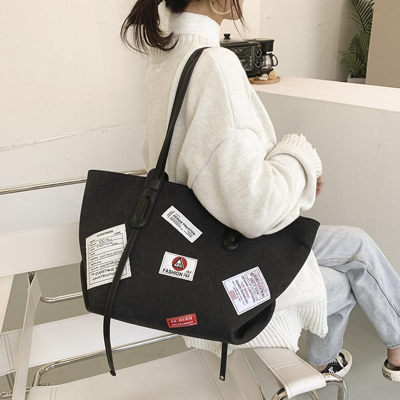 迪奥手提包 包包女包徽章大容量单肩包2020新款时尚洋气帆布托特包通勤手提包_推荐淘宝好看的迪奥手提包