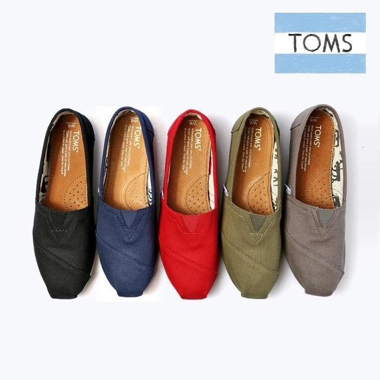 纯色帆布鞋 TOMS春夏季纯色经典款帆布鞋一脚蹬平底懒人鞋休闲男鞋女鞋情侣款_推荐淘宝好看的女纯色帆布鞋