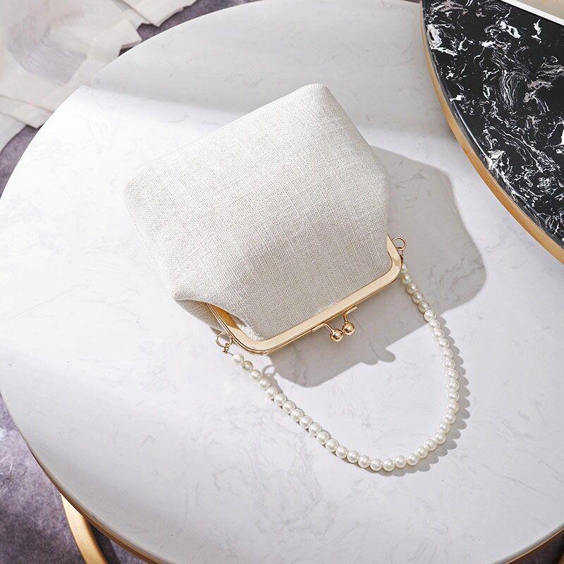 白色贝壳包 2020年新款珍珠夹子包单肩斜跨手提古风包包贝壳包百搭时尚手机包_推荐淘宝好看的白色贝壳包