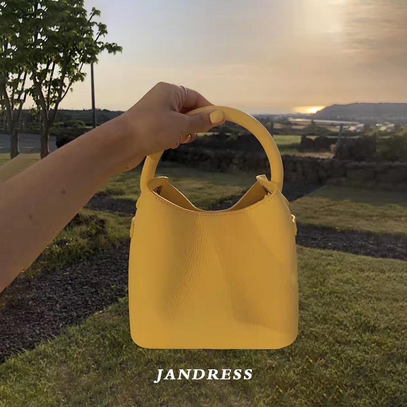 黄色水桶包 JANDRESS 2021新款春夏款柠檬黄色小包百搭ins手提斜挎水桶包包女_推荐淘宝好看的黄色水桶包