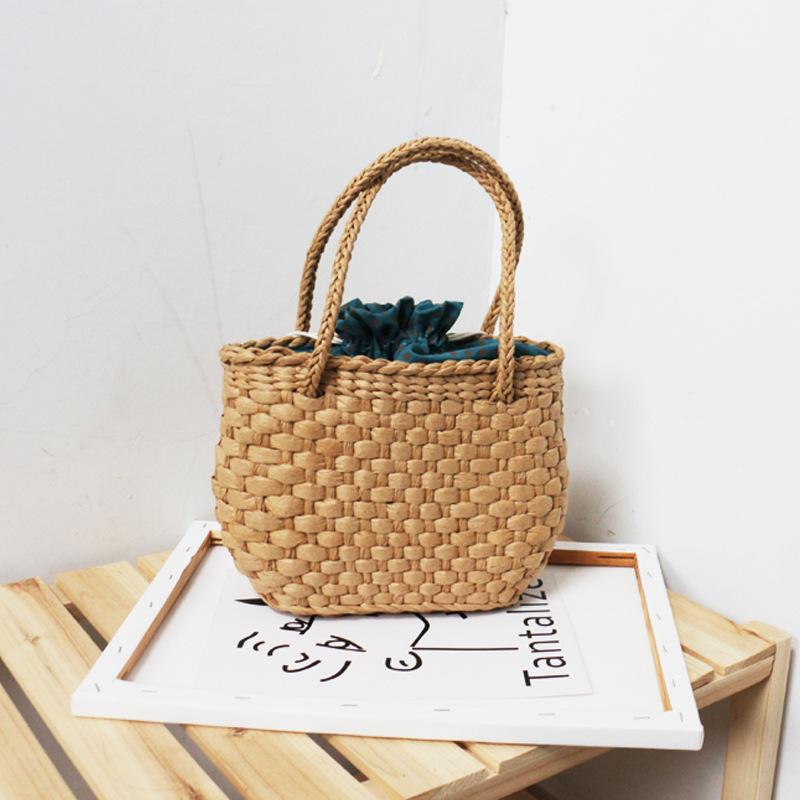 绿色草编包 2021新款绿色波点束口编织草编包沙滩度假小包女式手提包_推荐淘宝好看的绿色草编包