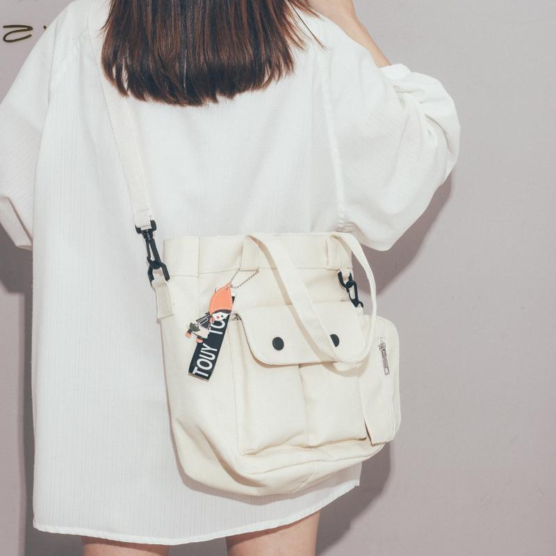 白色帆布包 大容量帆布包包女2020新款潮高中大学生斜挎包日系文艺单肩托特包_推荐淘宝好看的白色帆布包