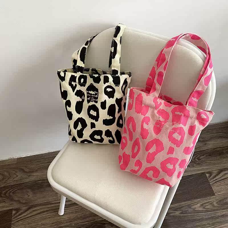 粉红色水桶包 托特手提包包袋包新款粉红色女2021包单肩水桶豹纹大容量休闲帆布_推荐淘宝好看的粉红色水桶包
