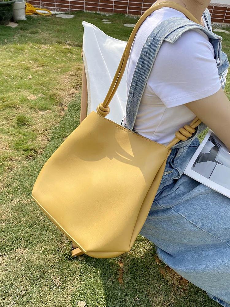黄色水桶包 奶黄色水桶托特包包女夏2021新款潮大容量今年流行时尚通勤单肩包_推荐淘宝好看的黄色水桶包