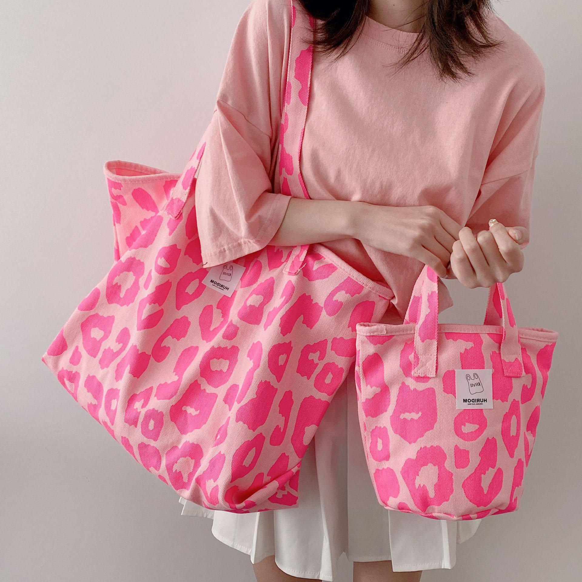 粉红色手提包 粉红色豹纹包大容量帆布单肩手提包女水桶包2021新款休闲托特包袋_推荐淘宝好看的粉红色手提包