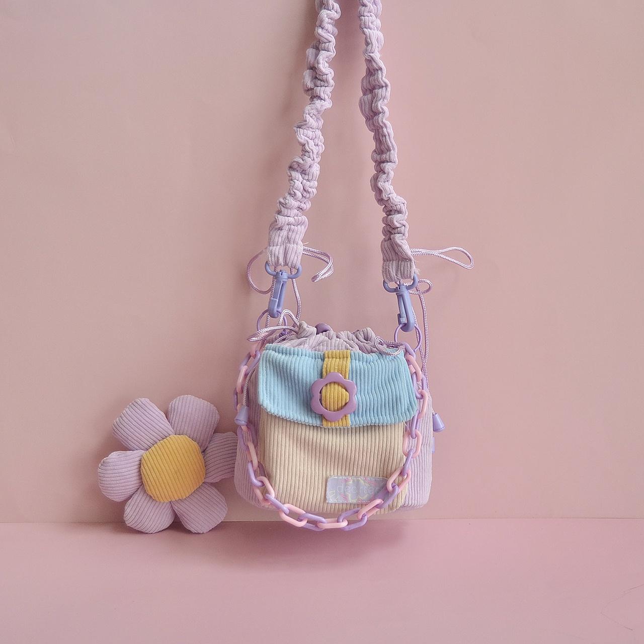 紫色水桶包 原创紫色包包女斜挎包灯芯绒撞色花朵包包可爱少女斜挎水桶包女_推荐淘宝好看的紫色水桶包