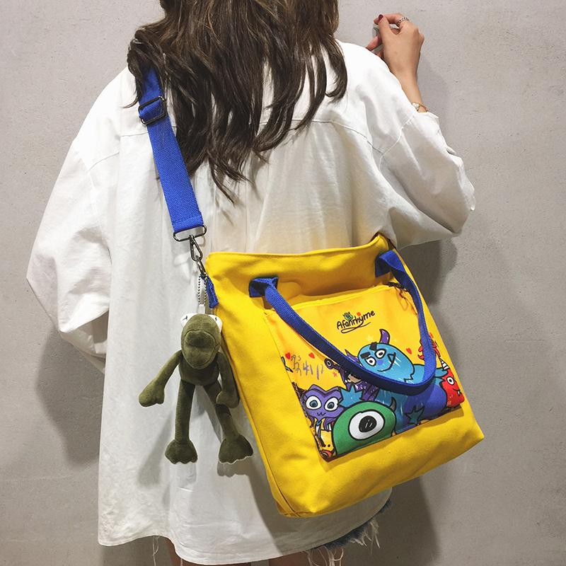 黄色斜挎包 帆布大包包女包新款2019卡通涂鸦布袋托特包学生大容量单肩斜挎包_推荐淘宝好看的黄色斜挎包