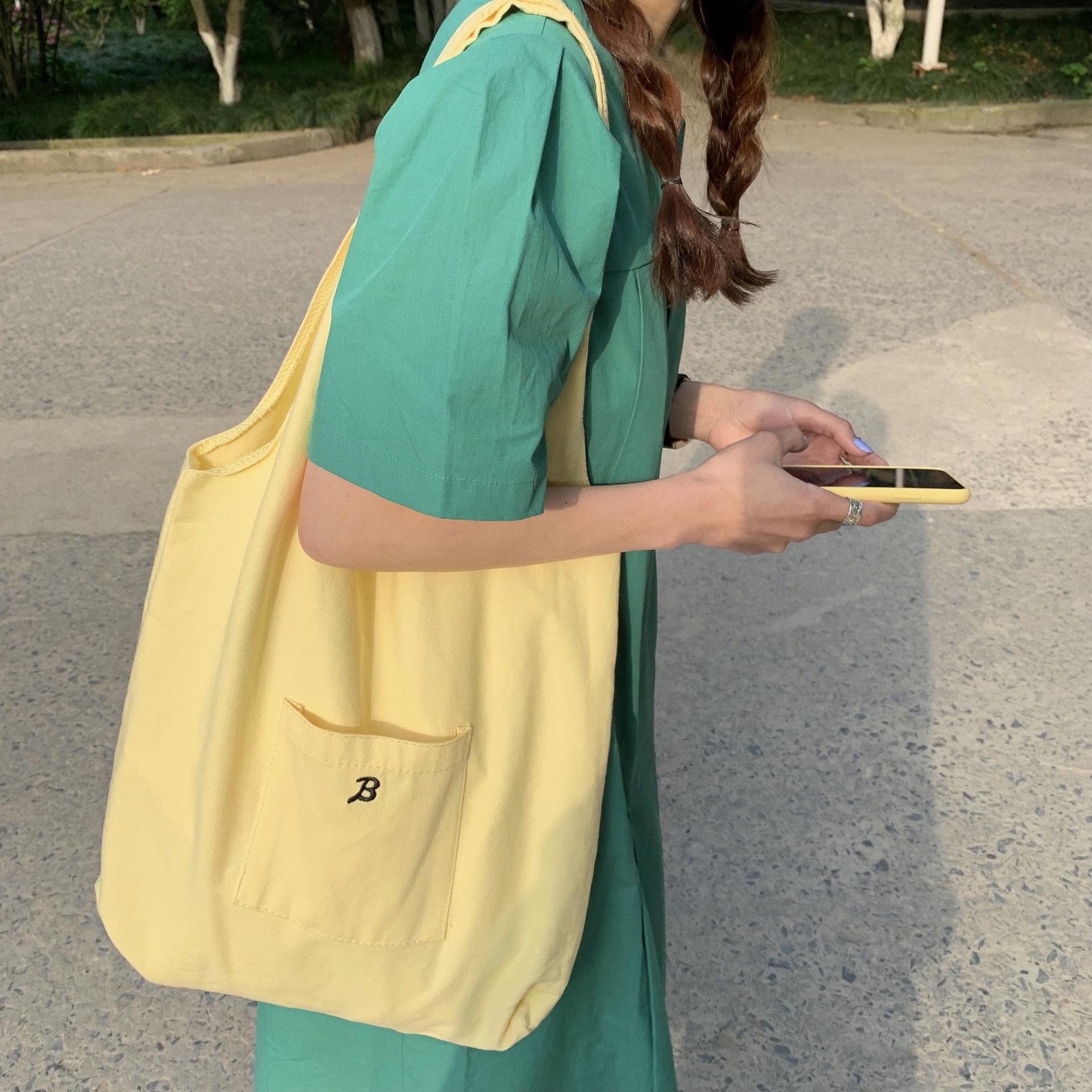 黄色糖果包 韩国chic新款糖果鹅黄色大容量购物袋奶黄帆布包ins少女单肩包袋_推荐淘宝好看的黄色糖果包