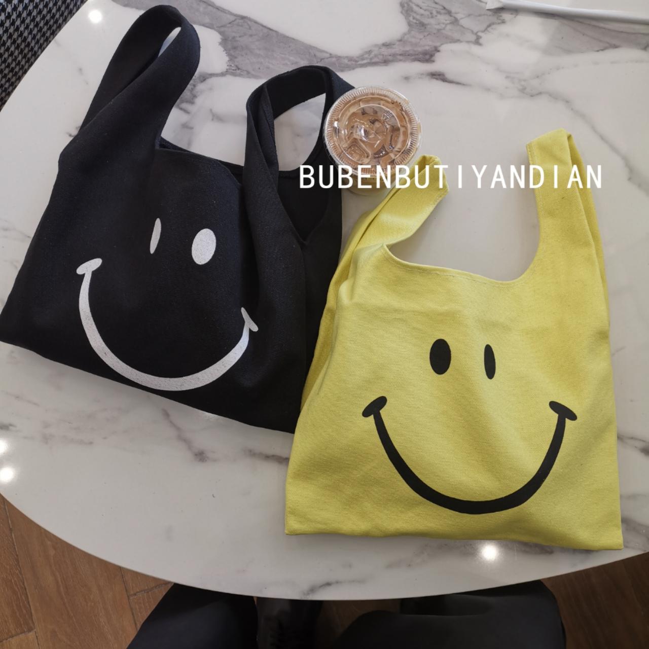 黑色手提包 自创新款手提笑脸帆布包女ins风小清新黑色黄色手腕东大门购物袋_推荐淘宝好看的黑色手提包