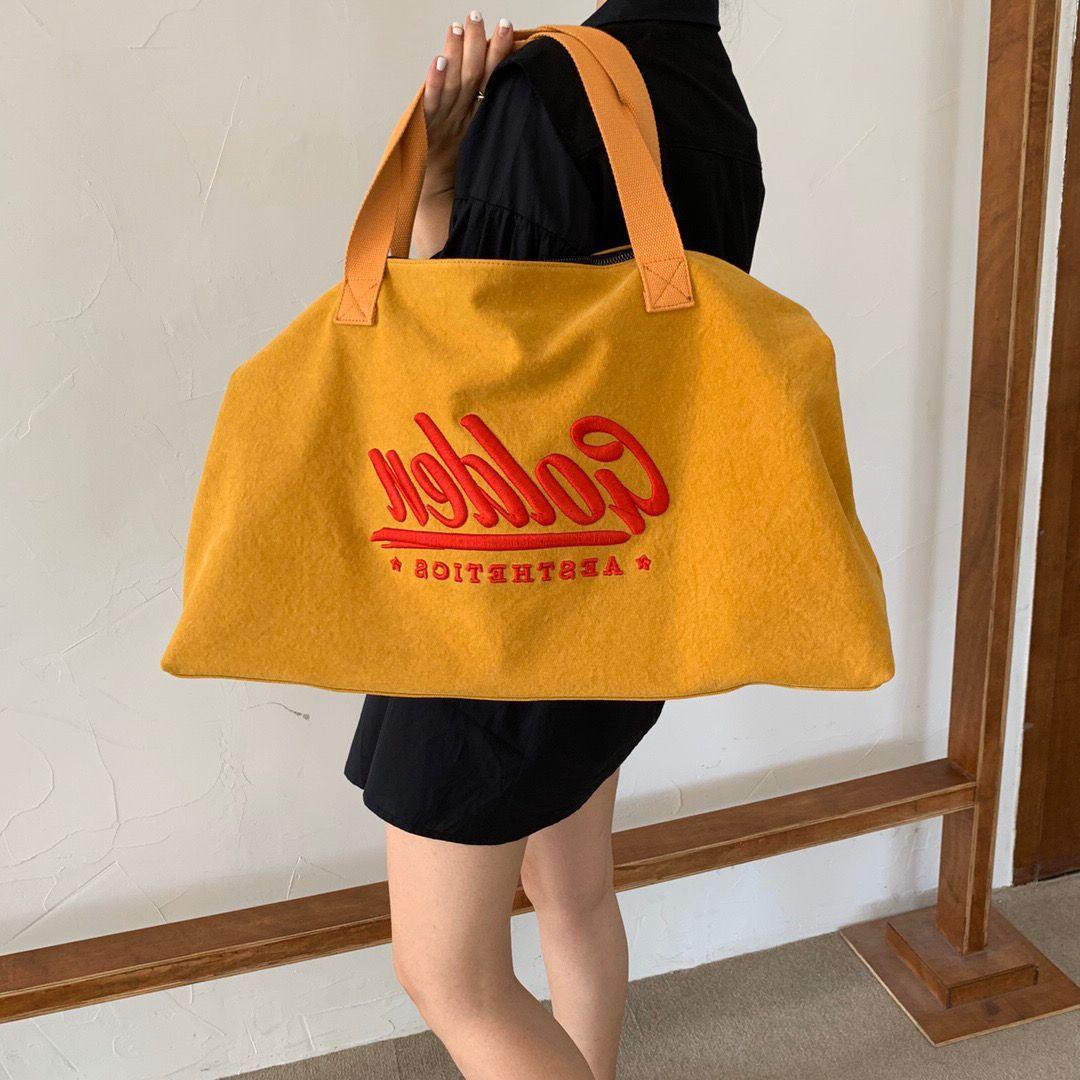 黄色帆布包 黄色帆布包包女2021新款潮大容量单肩手提托特女包外出短途旅行包_推荐淘宝好看的黄色帆布包