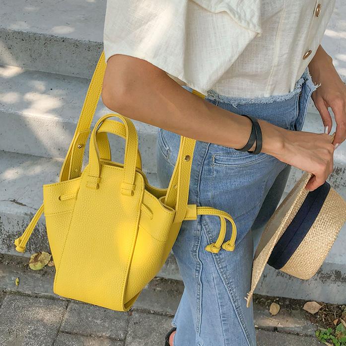 黄色糖果包 吊床包手提斜挎荔枝纹糖果色小包时尚柠檬黄色女包包可爱百搭现货_推荐淘宝好看的黄色糖果包