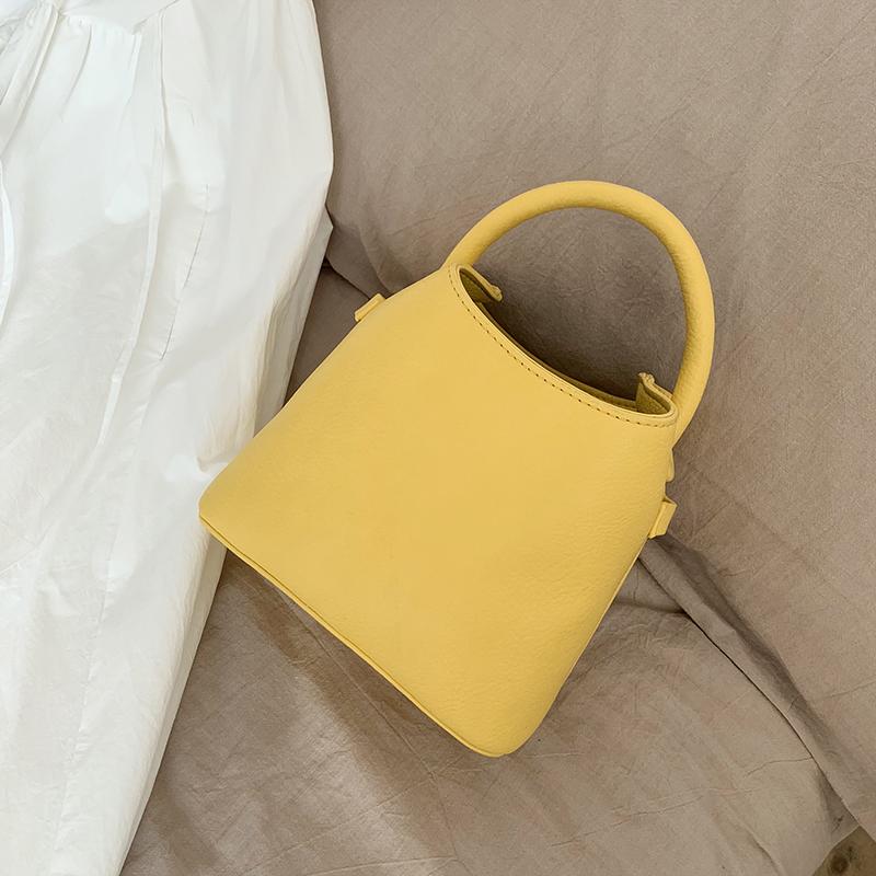 斜跨水桶包 韩国新款小众女包时尚纯色PU女式手提包水桶包ins百搭单肩斜跨包_推荐淘宝好看的斜跨水桶包