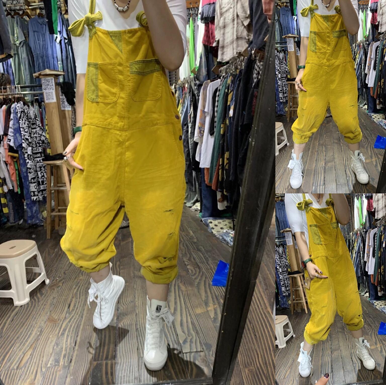 黄色牛仔裤 2021春季新款破洞磨白黄色牛仔背带裤女哈伦裤宽松大码显瘦百搭裤_推荐淘宝好看的黄色牛仔裤