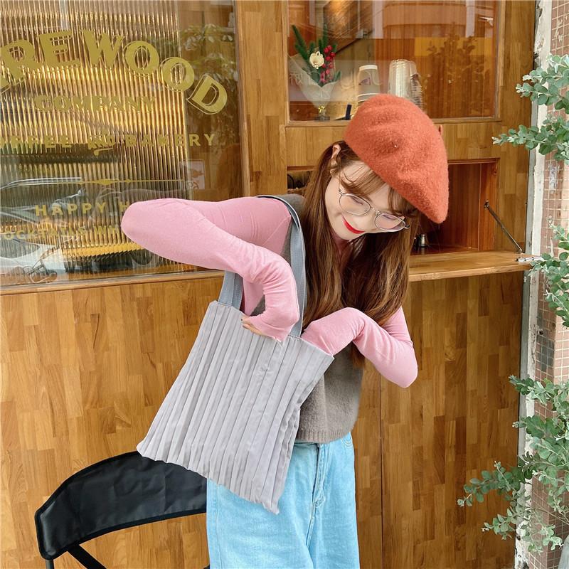 粉红色手提包 秋季新款韩版褶皱单肩手提布包学生上班百搭布袋包简约敞口粉红色_推荐淘宝好看的粉红色手提包