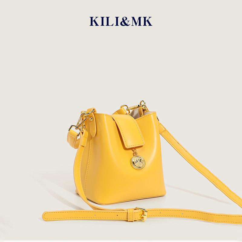 黄色水桶包 KILI&MK高级感洋气夏季黄色小水桶包包女2021新款潮大容量斜挎包_推荐淘宝好看的黄色水桶包