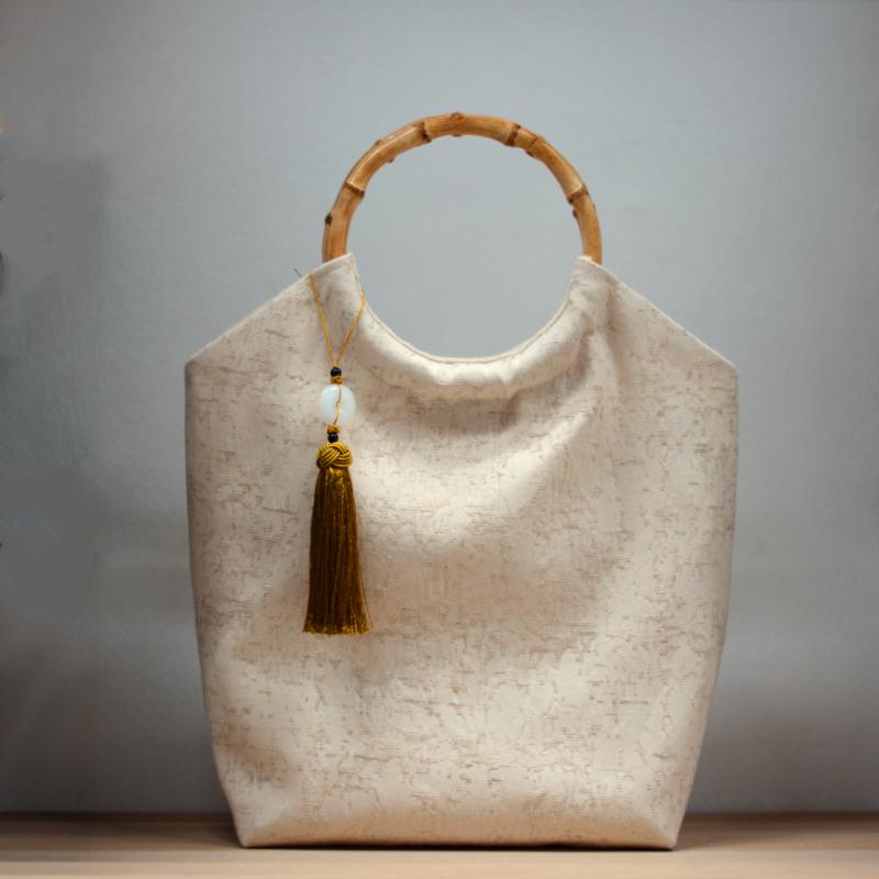 白色手提包 水云瓶复古棉麻圆环竹节手柄布包休闲手提帆布百搭纯白色文艺女包_推荐淘宝好看的白色手提包