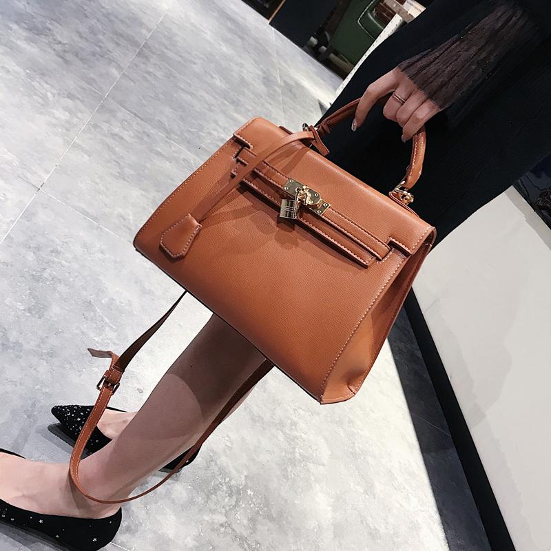 欧美时尚手提包 凯莉包包女2021新款欧美锁扣铂金女包简约时尚手提包潮单肩斜挎包_推荐淘宝好看的女欧美手提包