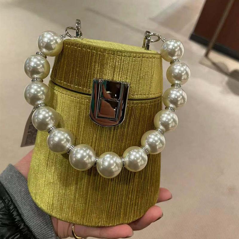 黄色水桶包 UR珍珠链条水桶包女潮2021新款网红小众设计质感单肩斜跨黄色小包_推荐淘宝好看的黄色水桶包