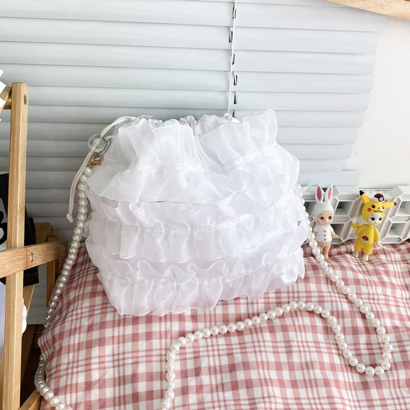 白色水桶包 仙气包包2021新款复古温柔珍珠单肩手提蕾丝仙女白色抽绳水桶小包_推荐淘宝好看的白色水桶包