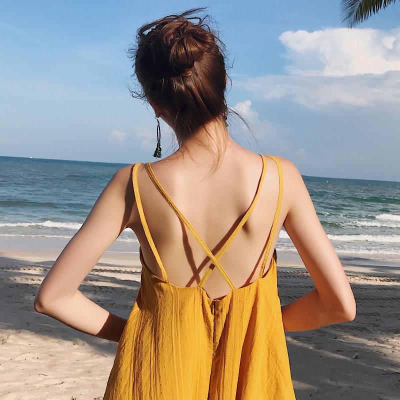 黄色连衣裙 zwmh旅行路上沙滩裙女海边度假吊带连衣裙夏波西米亚黄色露背长裙_推荐淘宝好看的黄色连衣裙
