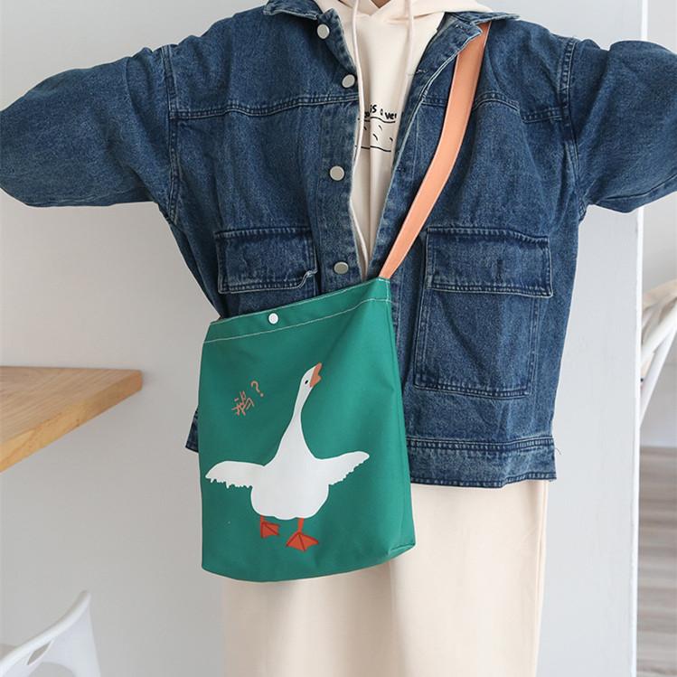 绿色帆布包 包邮搞怪大白鹅墨绿色帆布包两面图手提单肩包学生书包环保购物袋_推荐淘宝好看的绿色帆布包