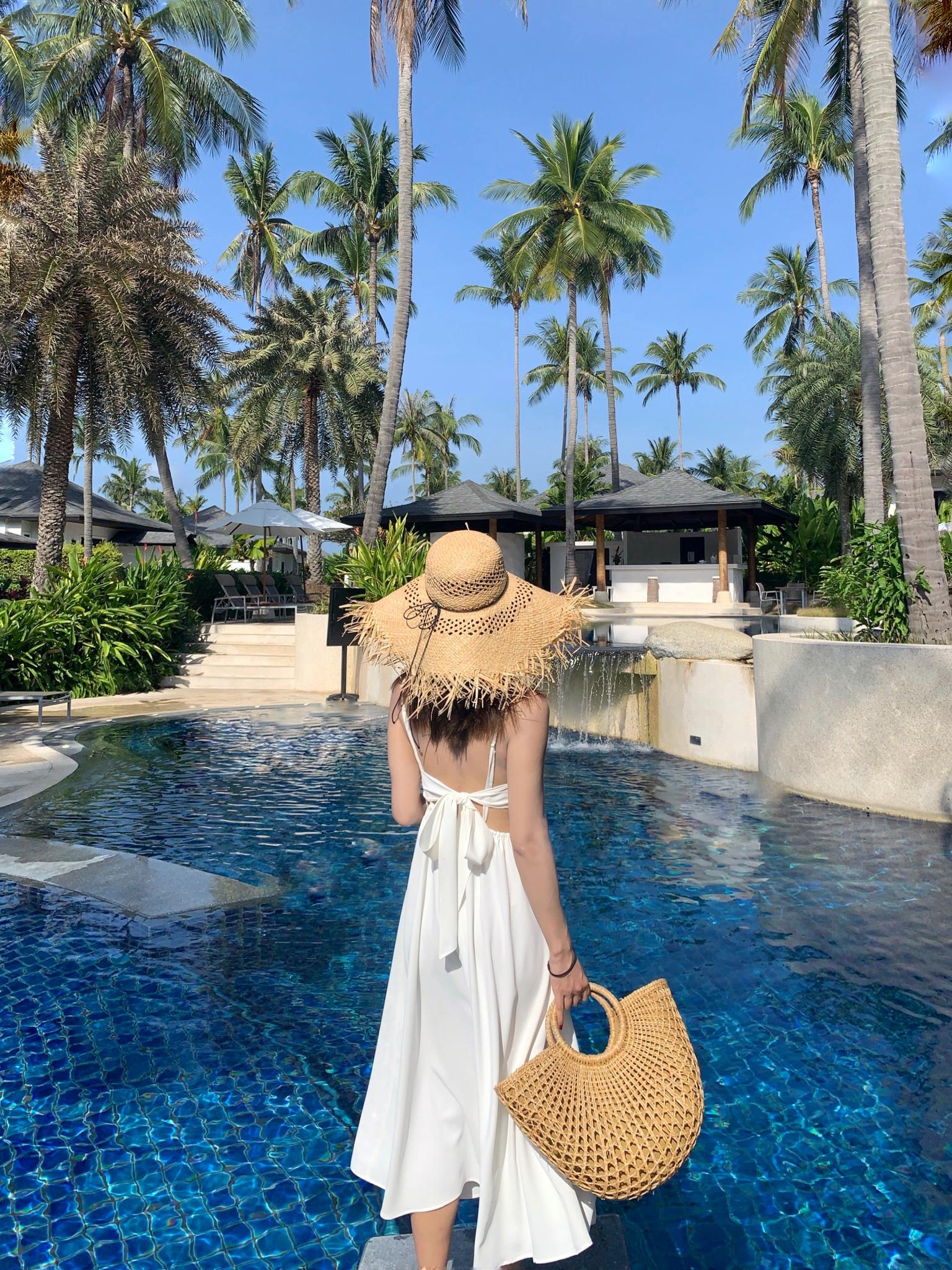 白色吊带连衣裙 drssholic 背影杀 度假风纯白色露背蝴蝶结吊带沙滩连衣裙无袖_推荐淘宝好看的白色吊带连衣裙
