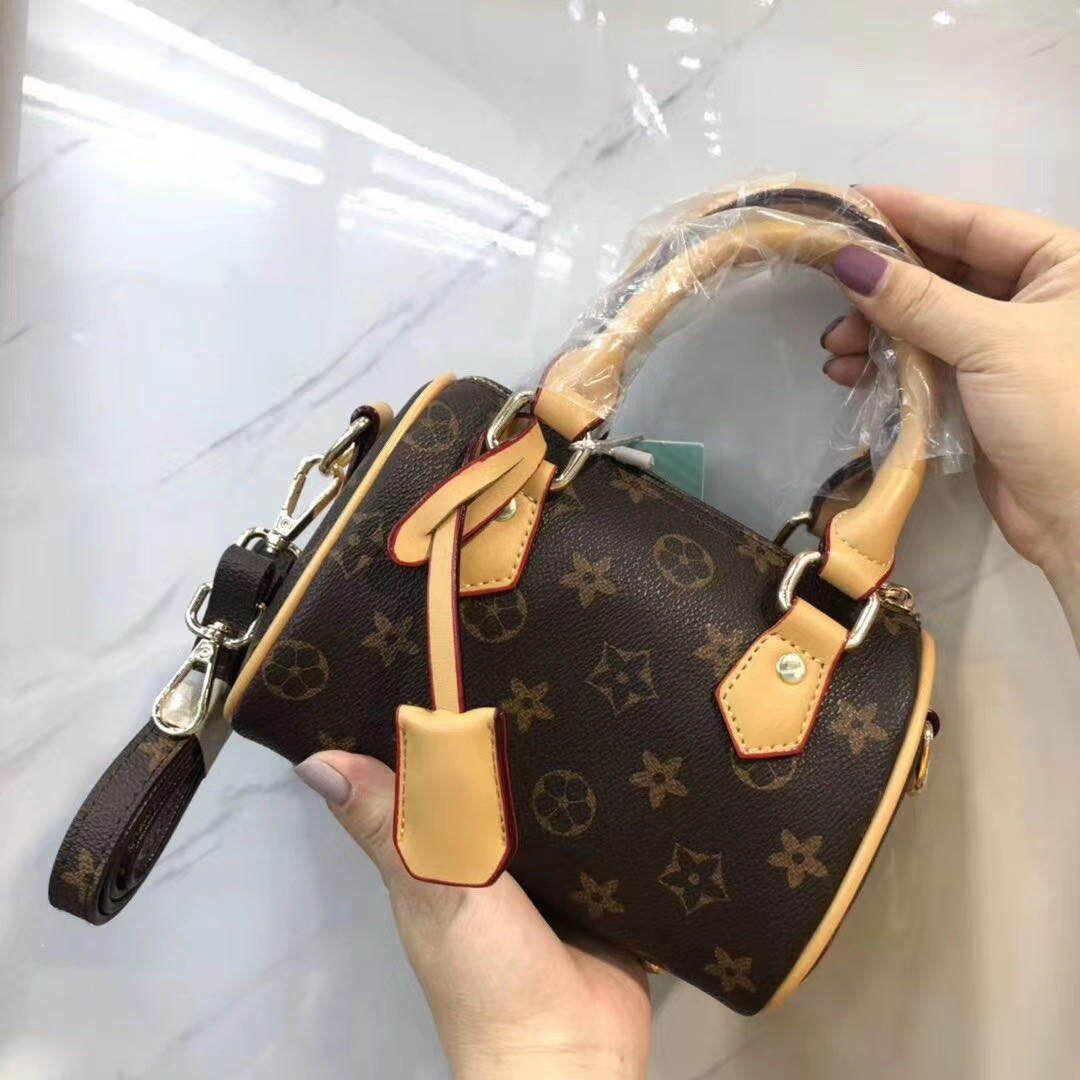 印花手提包 【Muusu】新款韩版复古女包手提印花水桶包枕头包小包包_推荐淘宝好看的女印花手提包