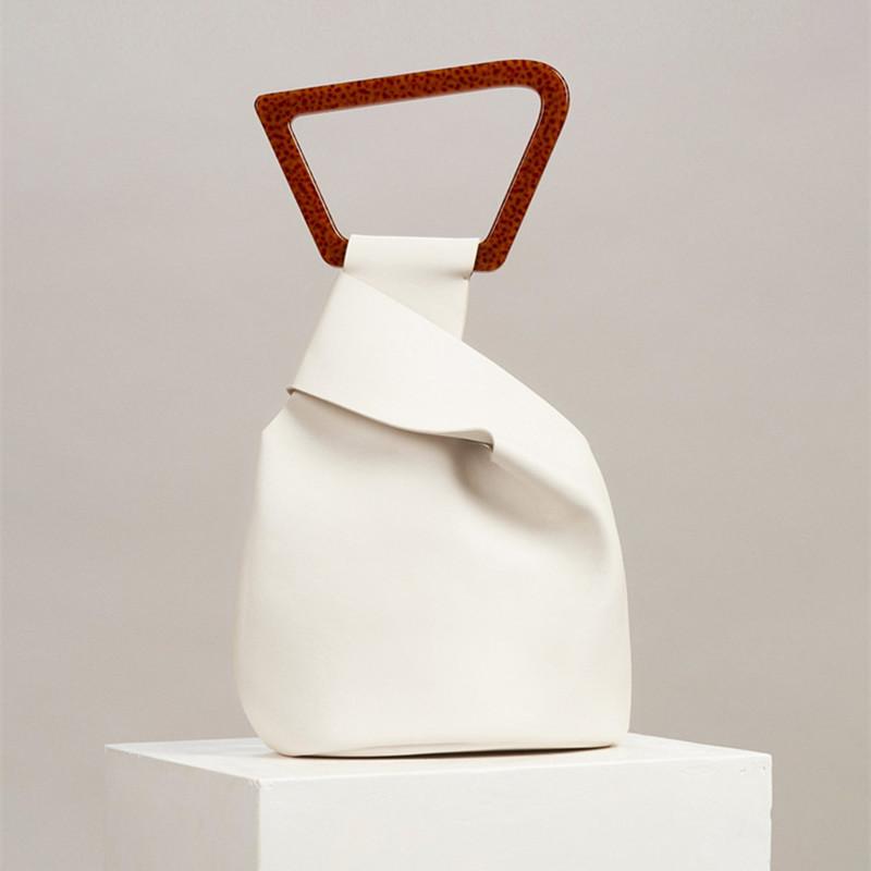 白色水桶包 欧美潮牌小众设计2020夏新款不规则水桶包女时尚个性亚克力手提包_推荐淘宝好看的白色水桶包