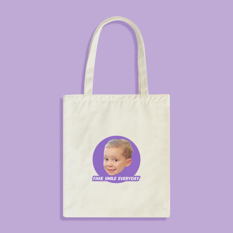 紫色单肩包 原创设计FakeSmile假笑男孩Gavin表情紫色黑白帆布单肩手提托特包_推荐淘宝好看的紫色单肩包